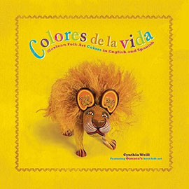the yellow cover of Colores de la Vida showing a lion figure.