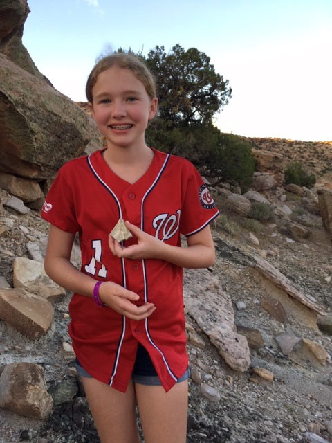 Young girl at Mesa Verde National Park with pottery shard