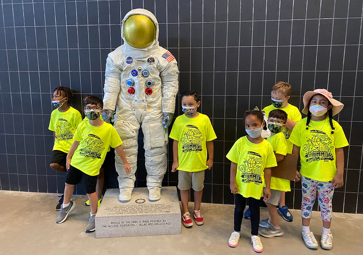 Young multicultural children in front of astronaut exhibition at Udvar Hazy Center
