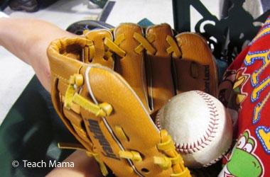 photo of a baseball mit with a baseball inside it