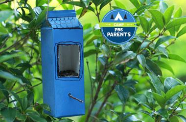 a bird feed made out of a milk carton