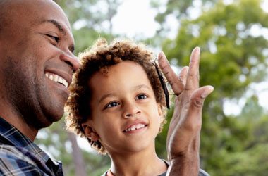 young child and a man with a bug on his finger