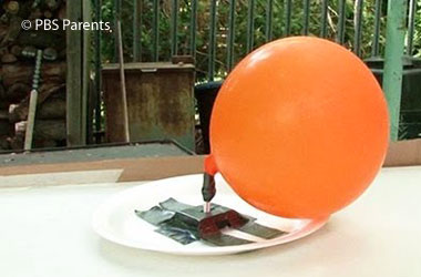 photo of balloon attached to a paper plate