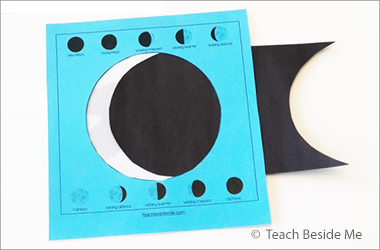 photo of a paper slider that illustrates the phases of the moon