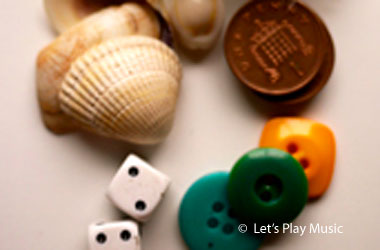 photo of shells, dice, buttons, and coins