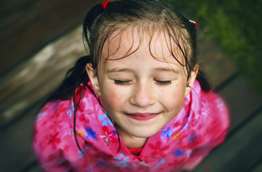 down shot of girl with wet face and hair