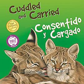 illustrated cover of English and Spanish bilingual book Cuddled and Carried showing adult and baby panthers.