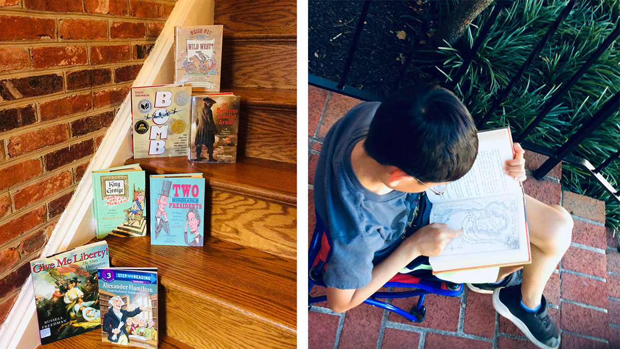 Staircase displaying nonfiction children's books and young boy reading outside during the summer