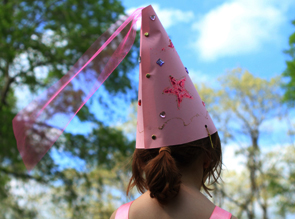 young child in a princess cone cap.